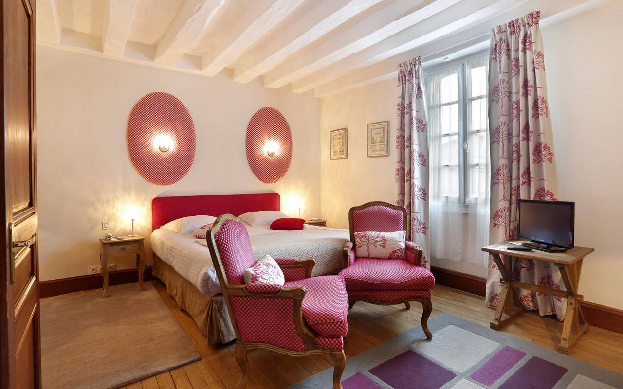 Purple room with television hotel tours